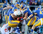 SIOUX FALLS, SD - NOVEMBER 7:  TJ Hassell #51 and Dallas Brown #15 from South Dakota State University gang tackle George Moreira #7 from Illinois State in the second half Saturday in the final game at Coughlin Alumni Stadium in Brookings. (Photo by Dave Eggen/Inertia)
