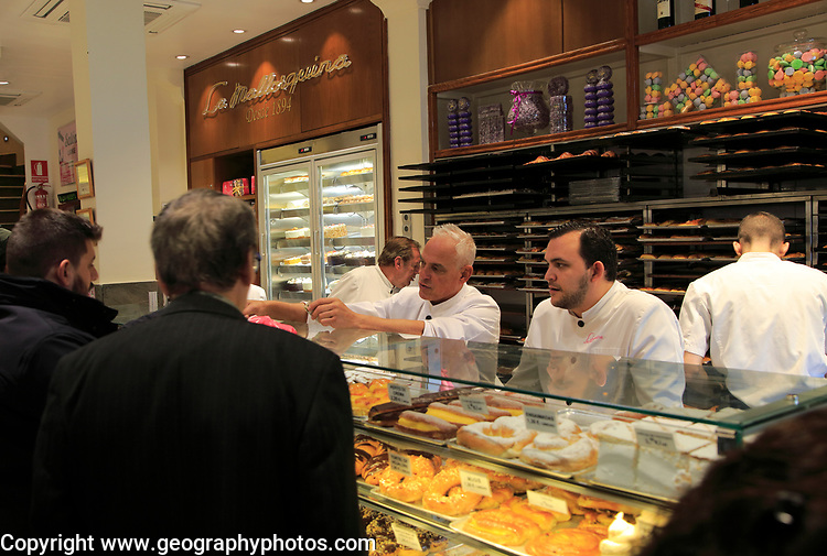 Customers inside baker confectionery shop, La Mallorquina, Calle Mayor, Madrid, Spain