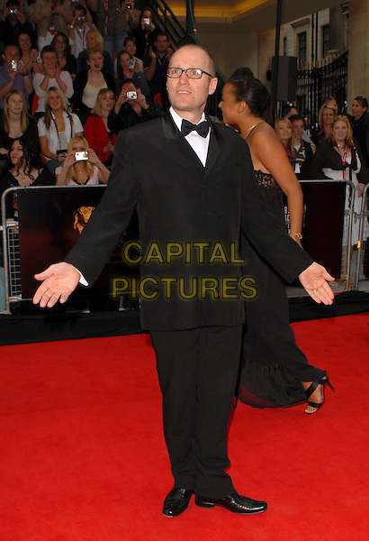 ADRIAN EDMONSON.Arrivals at the Pioneer British Academy Television Awards 2006 at the Grosvenor House Hotel, London, UK..May 7th, 2006 .Ref: CAN.BAFTA TV.full length black tuxedo Ade Edmondson.www.capitalpictures.com.sales@capitalpictures.com.©Capital Pictures