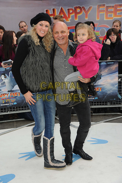 Nikki & Aldo Zilli & guest.European Premiere of 'Happy Feet Two' at the Empire Leicester Square, London, England..November 20th 2011.full length black hat grey gray fur gilet shirt pink coat kid child married husband wife.CAP/CAS.©Bob Cass/Capital Pictures.