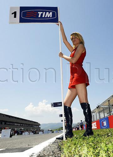 06 06 2010 Grid Girl.. Moto2 class, 600cc spec Honda eninges in prototype chassis. Gran Premio d'Italia TIM, Mugello circuit, Italy.