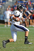30 October 2010:  FIU quarterback Wesley Carroll (13) carries the ball in the first quarter as the Florida Atlantic University Owls defeated the FIU Golden Panthers, 21-9, at Lockhart Stadium in Fort Lauderdale, Florida.