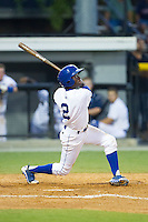 D.J. Burt (2) of the Burlington Royals follows through on his swing against the Princeton Rays at Burlington Athletic Park on July 11, 2014 in Burlington, North Carolina.  The Rays defeated the Royals 5-3.  (Brian Westerholt/Four Seam Images)