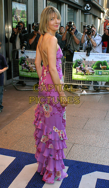 JEMMA REDGRAVE.I'll Be There Film Premiere at Odeon, Leicester Square.www.capitalpictures.com.sales@capitalpictures.com.©Capital Pictures.floral detail purple dress, frills, gold heels.full length, full-length