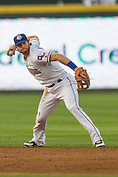 Round Rock Express shortstop Jason Donald (5) prepares to make a throw to first base during the Pacific Coast League baseball game against the Fresno Grizzlies on June 22, 2014 at the Dell Diamond in Round Rock, Texas. The Express defeated the Grizzlies 2-1. (Andrew Woolley/Four Seam Images)