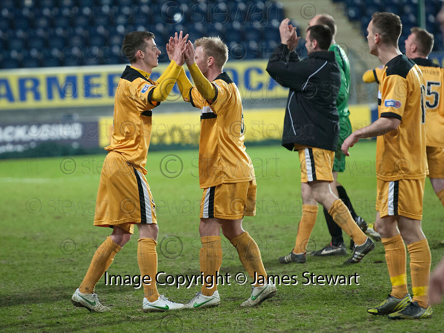 Dumbarton players celebrate at the end of the game.
