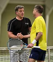 March 7, 2015, Netherlands, Hilversum, Tulip Tennis Center, NOVK, Ton van Rijthoven (NED) congratulates winner Wim Groeneveld (NED) (R)<br /> Photo: Tennisimages/Henk Koster
