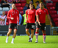 Lincoln City's Jason Shackell, Adam Crookes and Matt Rhead, left to right, during the pre-match warm-up<br /> <br /> Photographer Andrew Vaughan/CameraSport<br /> <br /> The EFL Sky Bet League Two - Lincoln City v Swindon Town - Saturday August 11th 2018 - Sincil Bank - Lincoln<br /> <br /> World Copyright &copy; 2018 CameraSport. All rights reserved. 43 Linden Ave. Countesthorpe. Leicester. England. LE8 5PG - Tel: +44 (0) 116 277 4147 - admin@camerasport.com - www.camerasport.com