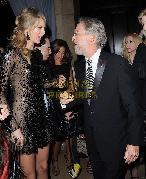 Taylor Swift and Neil Portnow attends Pre-GRAMMY Gala &amp; Salute to Industry Icons with Clive Davis Honoring Lucian Grainge held at The Beverly Hilton Hotel in Beverly Hills, California on January 25,2014                                                                                <br /> CAP/DVS<br /> &copy;Debbie VanStory/Capital Pictures