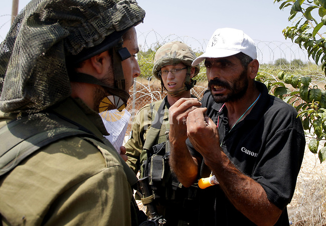 A Palestinian man argues with an Israeli soldier during a demonstration in Beit Omar village, north of Hebron, on July 10, 2010 against Israel's controversial separation barrier and the expansion of nearby Jewish settlements in the occupied West Bank. Photo by Mamoun Wazwaz