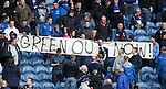 A section of fans in the Copland Road stand unveil a Green Out Now banner and a fan takes exception to it and tears it down