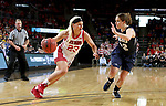 SIOUX FALLS, SD - MARCH 8: Madison McKeever #23 of the South Dakota Coyotes drives to the basket against Karly Gore #22 of the Oral Roberts Golden Eagles at the 2020 Summit League Basketball Championship in Sioux Falls, SD. (Photo by Dave EggenInertia)