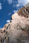 WY: Wyoming, Cody:.Granite at Buffalo Bill Dam.Photo #: yellow796..Photo copyright Lee Foster, 510/549-2202, lee@fostertravel.com, www.fostertravel.com..