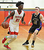 Julius Goddard #21 of Amityville, left, tries to get inside the paint as Nick Gonzalez #12 of Sayville guards him during a Suffolk County varsity boys basketball game at Amityville High School on Thursday, Jan. 5, 2017. Amityville won by a score of 81-73.