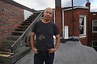 (171119RREI1941) Adilson, a former esquinero, on his apartment roof near La Esquina where Latinos have gathered for decades at the corner of Mt. Pleasant St. and Kenyon St. NW. to play chekers (damas). Washington DC.  Nov. 19 ,2017 . ©  Rick Reinhard  2017     email   rick@rickreinhard.com