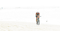 13 JUL 2013 - DEN HAAG, NED - Conrad Stoltz (RSA)  of South Africa leads on the bike as he races along the beach at the 2013 ITU Elite Men's Cross Triathlon World Championships in Kijkduin, Den Haag (The Hague), the Netherlands (PHOTO COPYRIGHT © 2013 NIGEL FARROW, ALL RIGHTS RESERVED)