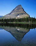 The Perfect Reflection Of A Glacially Carved Peak In A Mountain Lake At Glacier National Park, Hidden Lake, Montana, USA