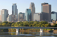 Dramatic view of the Minneapolis skyline and reflections over the Mississippi river in Minnesota, USA.