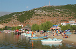 Tushemisht-Pogradec-Albania - August 02, 2004---Beach, boats and tourists at Lake Ohrid; region/village of project implementation by GTZ-Wiram-Albania (German Technical Cooperation, Deutsche Gesellschaft fuer Technische Zusammenarbeit (GTZ) GmbH); environment-landscape-tourism---Photo: Horst Wagner/eup-images