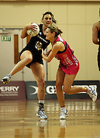NZ's Joline Henry takes a pass under pressure from Natasha Chokljat during the International  Netball Series match between the NZ Silver Ferns and World 7 at TSB Bank Arena, Wellington, New Zealand on Monday, 24 August 2009. Photo: Dave Lintott / lintottphoto.co.nz