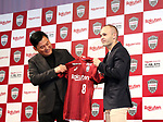 May 24, 2018, Tokyo, Japan - Spanish midfielder Andres Iniesta of former FC Barcelona shows his new uniform with Japan's online commerce giant Rakuten president Hiroshi Mikitani (L) as he joins Vissel Kobe of Japan's professional football league J-League in Tokyo on Thursday, May 24, 2018. Vissel Kobe is owned by Mikitani's Rakuten and Rakuten is now uniform sponsor of FC Barcelona.   (Photo by Yoshio Tsunoda/AFLO) LWX -ytd-