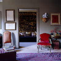 A velvet banquette is framed by the doorway leading from the living room into the study