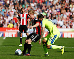 Mark Duffy of Sheffield Utd and Bradley Johnson of Derby County during the Championship match at Bramall Lane, Sheffield. Picture date 26th August 2017. Picture credit should read: Simon Bellis/Sportimage