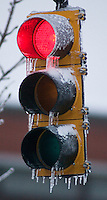 Icicles hang from a traffic signal in Westerville, Ohio, Thursday, December 23, 2004. A winter storm covered central Ohio with as much as a foot of snow and an inch of ice forcing school and business closings.