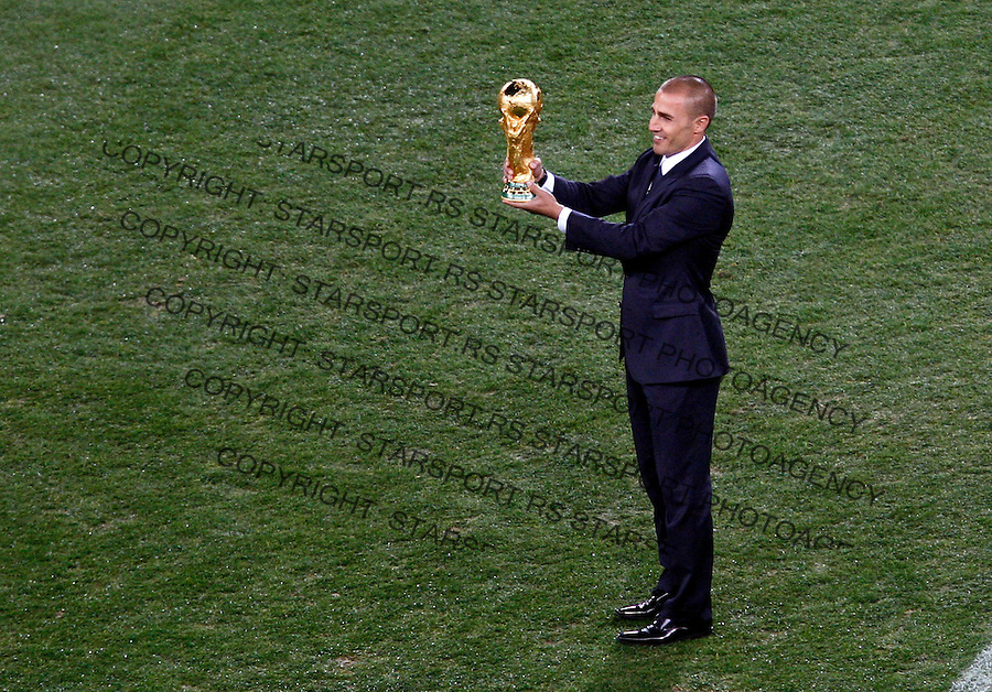 Fabio Cannavaro, captain of Italy football national team is presenting the FIFA world cup trophy before start of 2010 FIFA World Cup  final match, Netherlands vs Spain, Johannesburg, South Africa, Sunday, July, 11, 2010.  Soccer City Stadium (credit & photo: Pedja Milosavljevic / +381 64 1260 959 / thepedja@gmail.com / STARSPORT )