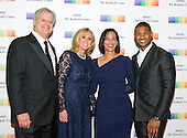 Singer Usher, right, his wife, Grace, right center, and guests arrive for the formal Artist's Dinner honoring the recipients of the 38th Annual Kennedy Center Honors hosted by United States Secretary of State John F. Kerry at the U.S. Department of State in Washington, D.C. on Saturday, December 5, 2015. The 2015 honorees are: singer-songwriter Carole King, filmmaker George Lucas, actress and singer Rita Moreno, conductor Seiji Ozawa, and actress and Broadway star Cicely Tyson.<br /> Credit: Ron Sachs / Pool via CNP