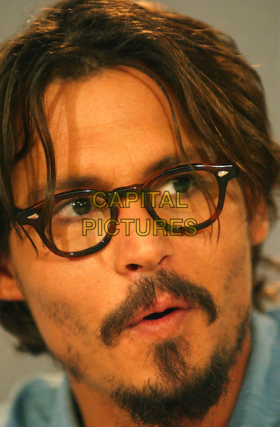 "JOHNNY DEPP.""Corpse Bride"". .Press conferences held at Sutton Place for the 2005 Toronto Film Festival, Toronto, Canada..September 10th, 2005.Photo Credit: Laura Farr/Admedia.headshot portrait glasses mustache goatee facial hair .www.capitalpictures.com.sales@capitalpictures.com.© Capital Pictures."