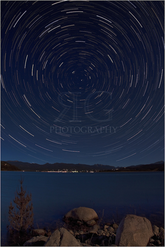 From the shores of Lake Granby near Grand Lake, Colorado, this Colorado image shows star trails over the calm lake on a summer evening. Using a series of long exposures, I blended together images taken over a few hours to show the rotation of the stars around the north star.