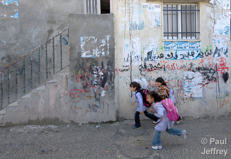 Girls running on their way home from school in the Daheisheh Refugee Camp in Bethlehem.