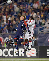 New England Revolution forward Edgaras Jankauskas (10) and Chicago Fire defender Dasan Robinson (32) battle for head ball. The New England Revolution tied the Chicago Fire, 0-0, at Gillette Stadium on October 17, 2009.