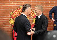 Pictured L-R: Managers Louis Van Gaal of Manchester United and Garry Monk of Swansea City greeting each other before kick off.  Saturday 16 August 2014<br />