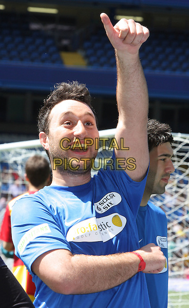 ANTONY COSTA.Celebrity Soccer Six in aid of The Samaritans held at Chelsea Football ground, Stamford Bridge, London, England..May 24th 2009 .football match game half length top blue arm in air thumb up funny face mouth open anthony stubble facial hair .CAP/ROS.©Steve Ross/Capital Pictures.