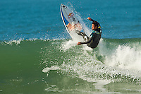 Jeffreys Bay, Eastern Cape, South Africa. Monday July 11 2011. Adriano de Souza (BRA) Freesurfing at Boneyards in 2'-4' clean south easterly swell.  Photo: joliphotos.com