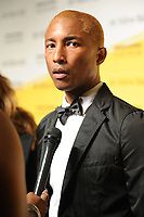BROOKLYN, NY - SEPTEMBER 10: Pharrell Williams at The Yellow Ball at The Brooklyn Museum in New York City on September 10, 2018. <br /> CAP/MPI99<br /> &copy;MPI99/Capital Pictures