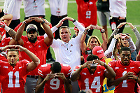 "Ohio State Buckeyes head coach Urban Meyer makes an ""O"" next to wife Shelley Meyer following their win over the Tulane Green Wave at Ohio Stadium in Columbus, Ohio on September 22, 2018. The Buckeyes beat the Green Wave 49-6. [ Brooke LaValley / Dispatch ]"