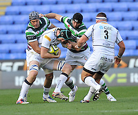 Reading, England. James Gaskell of Sale Sharks tackled  during the LV= Cup match between London Irish and Sale Sharks at Madejski Stadium on November 11, 2012 in Reading, England.