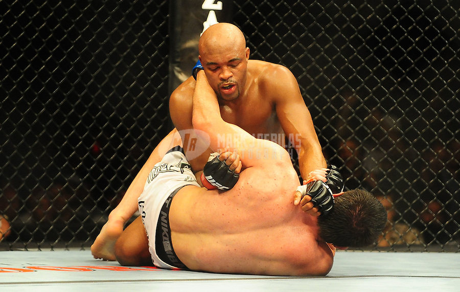 Aug. 7, 2010; Oakland, CA, USA; UFC fighter Anderson Silva (top) against Chael Sonnen (bottom) during the middleweight title bout in UFC 117 at the Oracle Arena. Mandatory Credit: Mark J. Rebilas