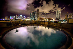 The skyline of Miami Florida is reflected in a pool on the 9th floor in downtown Miami, Florida