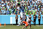 19 September 2015: UNC's Elijah Hood (34) catches the ball over Illinois' Clayton Fejedelem (20). The University of North Carolina Tar Heels hosted the University of Illinois Fighting Illini at Kenan Memorial Stadium in Chapel Hill, North Carolina in a 2015 NCAA Division I College Football game. UNC won the game 48-14.