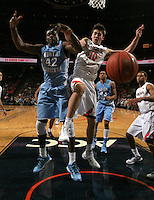 Virginia forward/center Mike Tobey (10) goes after the loose ball with North Carolina forward Joel James (42) during the second half of an NCAA basketball game Monday Jan. 20, 2014 in Charlottesville, VA. Virginia defeated North Carolina 76-61. (Photo/Andrew Shurtleff)