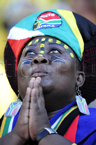 22 06 2010 female South African supporter prays for divine Assistance, Group A, 2010 World Cup match between France and South Africa in Bloemfontein, South Africa.