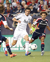 Vancouver Whitecaps FC midfielder Omar Salgado (17) on the attack as New England Revolution defender Kevin Alston (30) closes. In a Major League Soccer (MLS) match, the New England Revolution defeated Vancouver Whitecaps FC, 4-1, at Gillette Stadium on May 12, 2012.