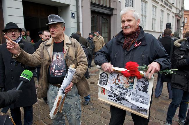Marsch von ehemaligen <br /> lettischen SS-Angehoerigen in Riga.<br /> Am Freitag den 16. Maerz 2012 marschierten ehemalige SS-Angehoerige aus Lettland, der sog. &quot;Lettischen Legion&quot; der Waffen-SS, durch die Lettische Hauptstadt Riga. Sie wurden begleitet von ca. 2000 Sympathiesanten aus ueberwiegend aus Osteuropa Europa. Der Marsch findet seit 1998 jaehrlich statt. Am 16. Maerz 1944 hatten die lettischen SS-Divisionen angeblich ihre ersten Kaempfe gegen die Sowjet-Armee. 1998 und 1999 war der 16. Maerz lettischen Nationalfeiertag.<br /> Links im Bild: Uldis Freimanis, Nazifuehrer in Lettland. 2011 Sagte er beim SS-Marsch live im Fernsehen, dass Juden erschossen und erhaengt werden sollten.<br /> March of former SS-Veterans from Latvia at Friday the 16th of March 2012 in Riga. The SS-Veterans where supported by neofascists and radical nationalists from mostly Europe.<br /> At the left: Uldis Freimanis, a prominent leader of the extreme right in Latvia. 2011 he said on live TV that Jews should be shot and hanged.<br /> 16.3.2012, Riga/Lettland<br /> Copyright: Christian-Ditsch.de<br /> [Inhaltsveraendernde Manipulation des Fotos nur nach ausdruecklicher Genehmigung des Fotografen. Vereinbarungen ueber Abtretung von Persoenlichkeitsrechten/Model Release der abgebildeten Person/Personen liegen nicht vor. NO MODEL RELEASE! Nur fuer Redaktionelle Zwecke. Don't publish without copyright Christian-Ditsch.de, Veroeffentlichung nur mit Fotografennennung, sowie gegen Honorar, MwSt. und Beleg. Konto: I N G - D i B a, IBAN DE58500105175400192269, BIC INGDDEFFXXX, Kontakt: post@christian-ditsch.de<br /> Bei der Bearbeitung der Dateiinformationen darf die Urheberkennzeichnung in den EXIF- und  IPTC-Daten nicht entfernt werden, diese sind in digitalen Medien nach &sect;95c UrhG rechtlich geschuetzt. Der Urhebervermerk wird gemaess &sect;13 UrhG verlangt.]