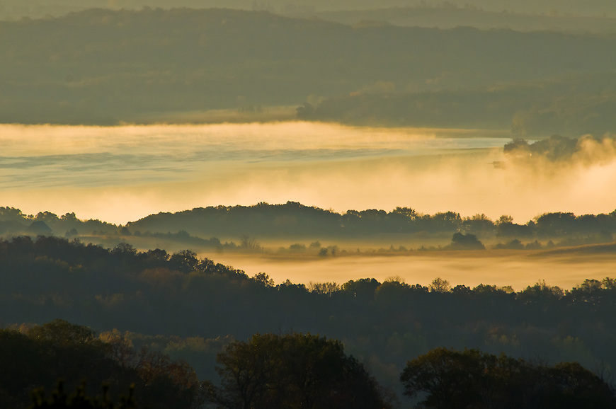 Morning mist rises above Lake Wisconsin as seen from Wawanissee Point in the Baraboo Hills