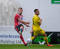 Lincoln City's Harry Toffolo crosses under pressure from Fleetwood Town's Lewis Coyle<br /> <br /> Photographer Andrew Vaughan/CameraSport<br /> <br /> The EFL Sky Bet League One - Lincoln City v Fleetwood Town - Saturday 31st August 2019 - Sincil Bank - Lincoln<br /> <br /> World Copyright © 2019 CameraSport. All rights reserved. 43 Linden Ave. Countesthorpe. Leicester. England. LE8 5PG - Tel: +44 (0) 116 277 4147 - admin@camerasport.com - www.camerasport.com
