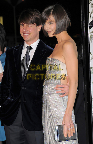 "TOM CRUISE & KATIE HOLMES .Overature Pictures' L.A. Premiere of ""Mad Money"" held at The Mann Village Theatre in Westwood, California, USA..January 9th, 2008.half length blue suit jacket strapless silver dress jewel encrusted clutch bag purse married husband wife beads beaded.CAP/DVS.©Debbie VanStory/Capital Pictures"